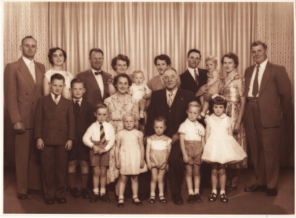 Family photograph of Bert Platt with his wife, children and grandchildren. Not all soldiers' stories ended unhappily. Bert Platt returned to the Parkes Shire and became a husband, father and grandfather. Here he is in a family photograph. Grandson Bob Gould is the young boy furthest to the left in the suit.