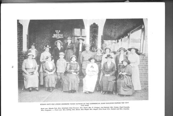 Members of the Bogan Gate Red Cross taken outside of the Commercial Bank building during the 1914-1918 War. Back Row: Maude Pett, Mrs Schofield, Elsie Rowson, Mrs Stack, Mrs R Hodges, Joe Haylock, Mrs Coster, Pearl Coombs, Mrs Ferguson, unknown. Front Row: Mrs Solling, Mrs Black, Mac Magill, Mrs Mrs Magill, Kitty Hood, Mrs Herbert and Mrs Coombs