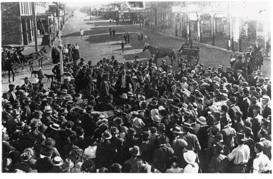 A reception in the Square to welcome returning solider, Roy Stewart in 1915. Clarinda Street continues into the background while Welcome Street can just be seen (where a horse and buggy are in top left of photograph) Source: Parkes: A Photographic History by Ian Chambers, 1988 Self-published: Parkes, NSW page 125