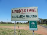 Photograph of signage at Lindner Oval, Peak Hill. Photograph by Sandie Ward (Parkes Shire Library) taken on February 10th, 2016. In the background are the changing sheds and canteen amenities buildings.