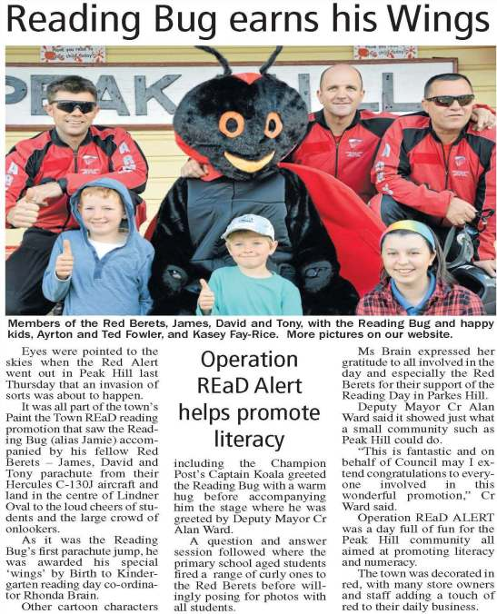 Members of the Red Berets who parachuted onto Lindner Oval. They are joined with the Reading Bug and happy residents - just three of the hundreds of residents who turned out to witness this amazing spectacle. Source: Parkes Champion Post Monday, September 1, 2014
