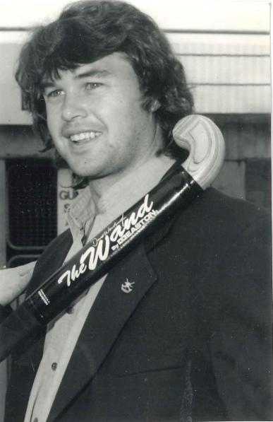 "Stephen Davies, sans headband, posing with ""The Wand"". John Davies says this was a popular hockey stick at the time. Made by Easton it was aluminium frame with a wooden head. They were later banned by FIH due to the wooden head detaching from the aluminium! Photograph courtesy of John and Brenda Davies"