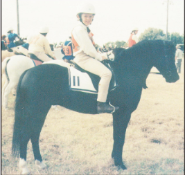 Photograph of young Peter McMahon on his first horse, Willy. Peter's grandfather, the late Tom McMahon, bought the horse for him. Source: Parkes Champion Post Friday August 8, 2008 page 8