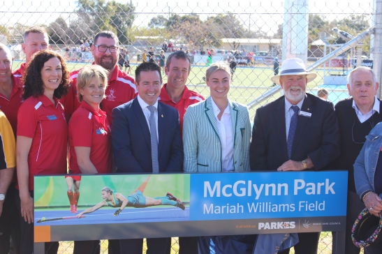 Photograph from the Official Opening of the Mariah Williams Field at McGlynn Park. Mariah Williams is seen with Minister for Racing Paul Toole and Cr Ken Keith OAM, Mayor of Parkes Shire along with members of the community and Parkes Hockey Inc. Photograph from Parkes Shire Council Media Release, taken August 26th, 2017