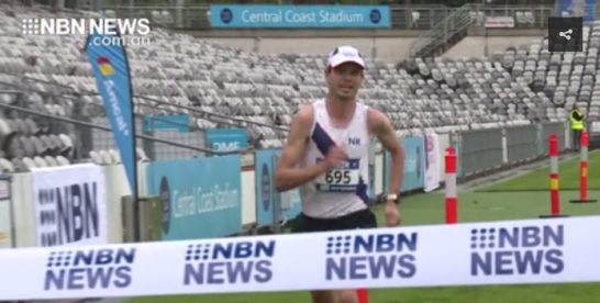 Still photograph of video footage highlighting Scott Westcott's win in the half marathon event at the Bay To Bay Running Festival. Source: NBN News website