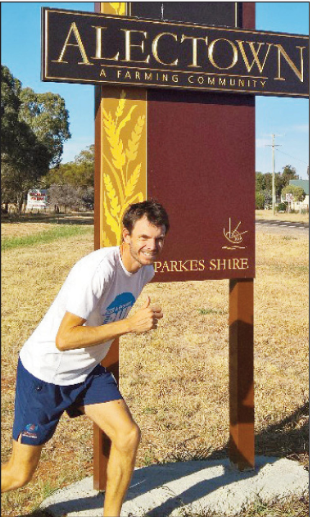 "The ""Alectown Ace"" posing next to his home town's sign. [Digital image]. (2016, April 28). Retrieved July 08, 2016, from http://www.parkeschampionpost.com.au/story/3875674/scott-poised-for-dream-run/"