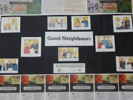 Photograph of the rear side of Parkes Library's History Week display. The theme this year is Neighbours. Photographs from Parkes Champion Post's feature of Good Neighbours Awards 2016. Photograph by Dan Fredericks (Parkes Shire Library) taken September 2, 2016