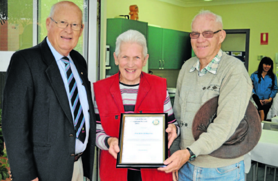 Rotary president, Peter Woods (left), with nominated Pam and Keith MacRae. The MacRaes were nominated by Rhonda Brain (absent). Source: Parkes Champion Post 7 June 2013