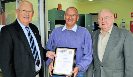 Rotary president, Peter Woods (left), with nominated Robert Irving (centre) and his nominator, Bernie Crowe (right). Source: Parkes Champion Post 7 June 2013