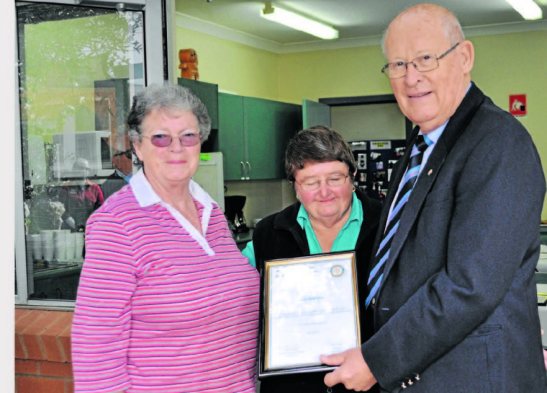 Nominator, Pat Bailey (left) with her Good Neighbour Cae Angrave (centre) and Rotary president, Peter Woods (right). Source: Parkes Champion Post 7 June 2013
