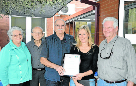 Winner of the 2014 Parkes Good Neighbours Award, Margaret Jones (centre) receives her prize from Rotarian, David Hughes. The neighbours who nominated her are also pictured: Jeanette and Mick Holland (left) and Terry Hetherington (right) Source: Parkes Champion Post 18 May 2014