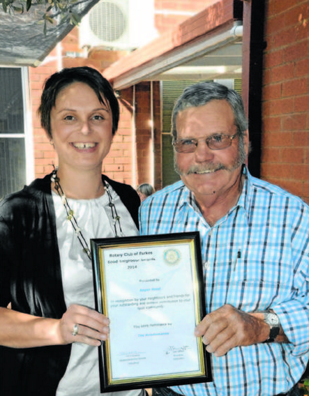 Indigo Kriedmann, representing nominators the Kriedmann family, with Good Neighbour nominee Roger Hood. Source: Parkes Champion Post 18 May 2014