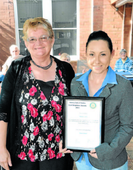 Rose Jones (left) nominated Parkes SES as her Good Neighbours. The nomination was collected by SES member, Amanda Corcoran. Source: Parkes Champion Post 18 May 2014