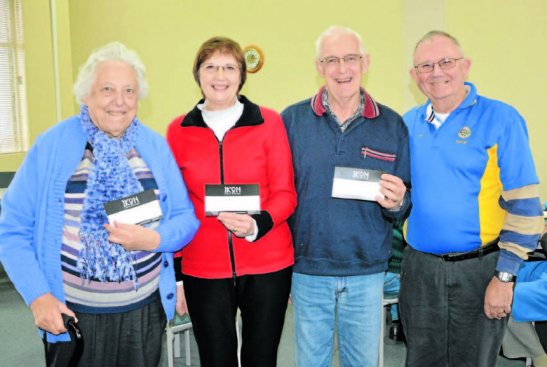 Nominator Judy Thornton with her Good Neighbours Muriel and Graham Lancaster presented with their Ikon Restaurant vouchers by Rotarian president Col Offner. Source: Parkes Champion Post 22 June 2015
