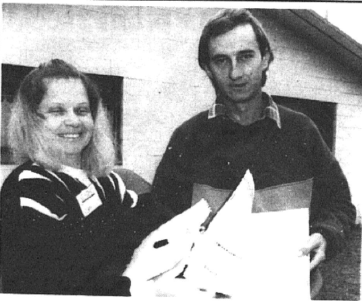 Newspaper photograph showing Census collector, Dorelle Grady leaving a Census form with Bob Nelson. Source: Parkes Champion Post Monday August 5, 1991 page 3