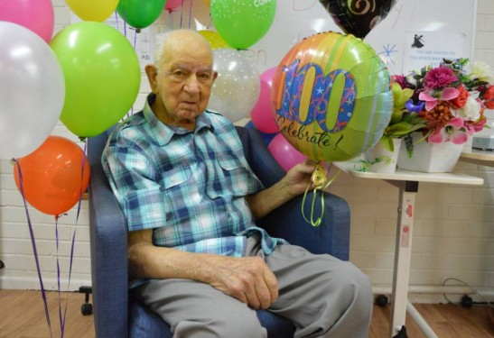 Photograph taken on the occasion of Len Unger's 100th birthday. Born February 27, 1917 Len has lived his whole life in the Parkes Shire. Starting at the family farm, Rocky Point then Talbot Street, Parkes and then Rosedurnate Aged Care Plus Centre. Source: Speelman, C. (2017, February 27). Century [Photograph found in Len Unger of Alectown turns 100, Parkes Champion Post, Parkes]. Retrieved April 26, 2017, from http://www.parkeschampionpost.com.au/story/4494353/len-was-determined-to-turn-100/ (Originally photographed 2017, February 27)