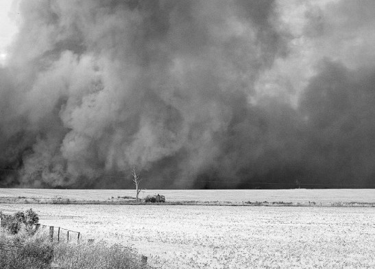 Like all farming towns, natural disasters will demonstrate their devastating impact at various times. This photograph is from the bushfire that engulfed Alectown on 30th November 2004. Source: Parkes Champion Post Monday June 26, 2006 page 3