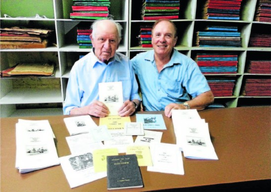 Len (at age 97 years old) in 2014 with nephew Don Unger and some of the books that he had researched and published. Photo: Parkes Champion Post website