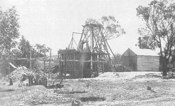 "Photograph of Koh-I-Noor Mine from Ian Chambers' fascinating book Parkes: A Photographic History. Chambers states that the mine was situated on land between the present golf club and the Forbes Road. The photograph dates back to the turn of the century and displays the ""modern"" wood-fired boiler (the shed on the right). Serious losses were experienced in winter due to the damage to the mine by the snow and also lack of procuring firewood for the boiler. Sources: Chambers, I. (1988). Parkes: A Photographic History. Parkes, N.S.W.: I. Chambers; and Western Champion Friday 7 December 1900 page 11"