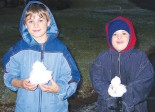 Cropped photograph of the front page of Parkes Champion Post featuring visiting Max (11) and Casey (9) who were travelling with their parents to Noosa and stopped over in Parkes the very day that it snowed! Source: Parkes Champion Post Friday June 24, 2005 page 1