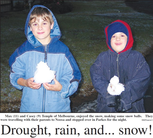 The headline highlights the contrary Australian weather! The front page of the local newspaper featured two boys on holiday with their parents and stopping off in Parkes on the very day that it snowed! Source: Parkes Champion Post Friday June 24, 2005 page 1