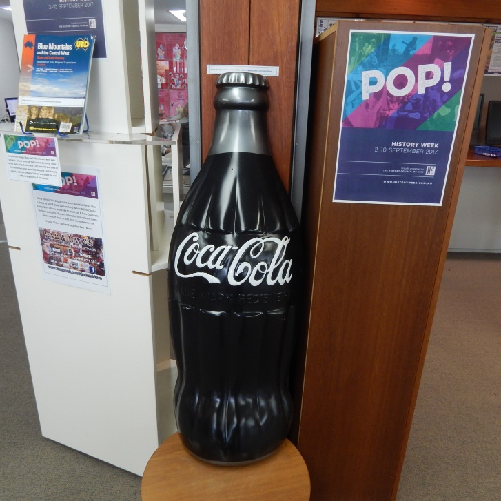 Such is the marketing genius behind this carbonated beverage that Coca Cola is synonymous with pop culture. A global icon, it has spawned many merchandise tie-ins such as this giant promotional bottle.  This item is on loan courtesy of Dad & Dave's Collectables