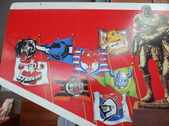 This is a promotional poster for the NSWRL (now known as the NRL) It has historical significance to, due to the fact that former rugby league teams are featured here. The defunct teams include North Sydney Bears, Illawarra Steelers (emblems pictured here), Gold Coast Seagulls, Western Suburbs Magpies (featured on second photograph). The emblems of all current NRL teams have changed too, adding to the nostalgic value of this item. This item on loan courtesy of Dad & Dave's Collectables http://www.facebook.com/dadanddave