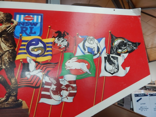 This is a the second part of the promotional poster for the NSWRL (now known as the NRL) It has historical significance to, due to the fact that former rugby league teams are featured here. The defunct teams include North Sydney Bears, Illawarra Steelers (emblems pictured in previous photograph), Gold Coast Seagulls, Western Suburbs Magpies (pictured here). The emblems of all current NRL teams have changed too, adding to the nostalgic value of this item. This item on loan courtesy of Dad & Dave's Collectables http://www.facebook.com/dadanddave