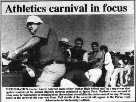 A regular feature during the month of May are the many school athletics carnivals. This photograph, featuring former mathematics teacher and current volunteer of many services Laurie Ashcroft, leading the staff in a tug-o-war duel against students. The winning house in 1990 was Sturt. Source: Parkes Champion Post Monday, May 21, 1990 page 18