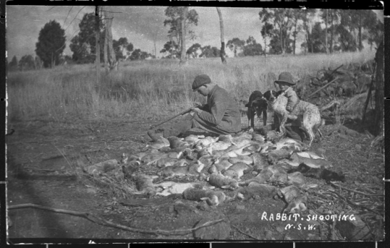 "Photograph taken by Albert Berthold ""Bert"" Unger of his brother-in-law Carl ""Otto"" Salan and his eldest son Herb Unger (Len's eldest brother) after shooting rabbits on the ""Rocky View"" property. Source: State Records"