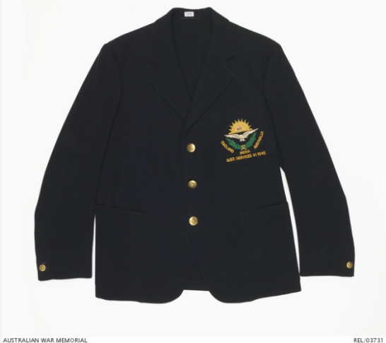 Photograph of a blazer worn by Cec Pepper and his teammates in the Australian Services XI. The description on the website states that this is a single breasted navy blue blazer with two patch pockets below the waist and an embroidered patch pocket on the left breast. The embroidery consists of a yellow rising sun over a white eagle with an green leaf spray below. The words 'ENGLAND INDIA AUSTRALIA AUST. SERVICES XI 1945' are embroidered in yellow at the bottom. The blazer body is unlined except for a yoke of wool across the upper back. The sleeves are lined with white cotton. There are three brass RAAF buttons on the front with a smaller RAAF button on each cuff. This particularly blazer belonged to Sergeant Charles Frederick Thomas Price. Source: Australian War Memorial website