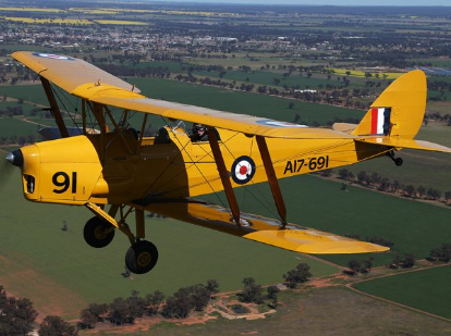 Photograph of de Havilland .82 Tiger Moth. The DH.82 were the planes that all training pilots in Australia would have flown. The yellow markings indicate that it was a trainer during World War II. Source: Temora Aviation Museum website