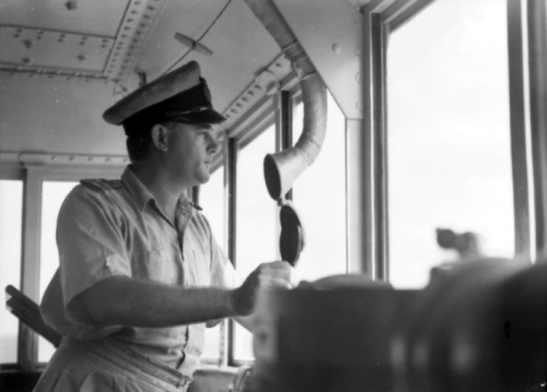 Lieutenant Commander N.O. (Paddy) Vidgen RAN, captain of HMAS Parkes on the bridge. Source: Royal Australian Navy website