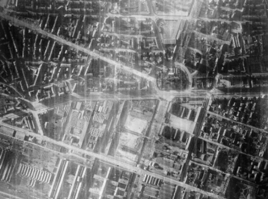Vertical night aerial photograph taken over Turin with the aid of a 4.5 inch Photoflash bomb, during a raid by aircraft of Bomber Command. The area illuminated is around the Piazza Adriano (right of centre), crossed by Corso Francesco Ferrucci and Corso Vittorio Emanuele II. Source: World War II Today website
