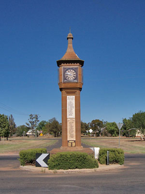 Photograph of the War Memorial Clock Tower. The square clock tower built of sandstone with plaques attached. Since 2007 the original stone plaques have been replaced with brass ones. Source: War Memorial Register website