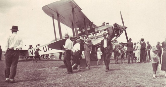 Photograph of Captain Les Holden and his de Havilland DH61 at Armidale. Captain Holden would land in paddocks and take members of the public for joy-rides. When he landed in Gilgandra, Rawdon Middleton experienced his first flight. Source: New England blog