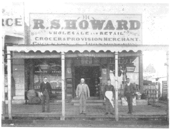 "Ian Chambers recorded that ""The retailing sore of R S Howard & Sons was destined to grow from this single shop (established in 1871 as Wallis & Howard) to a multi-departmental emporium, the equal of any in country NSW, owned and operated by four generations of the Howard family. Owen J Howard, Robert Stephen Howard and S W Howard pose with a customer in this photograph taken about 1885"" Source: Chambers, Ian (1988) p.32"