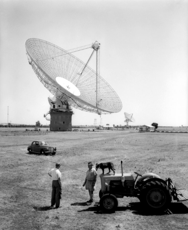 "Local farmers at The Dish in 1965: (L) Maurice Puttock, (R) ""Austie"" Helm. No, we don't know the name of the dog. So reads the caption of CSIROscope, the blog of the Commonwealth Scientifice and Industrial Research Organisation. Source: CSIRO website which can be found at https://blog.csiro.au/where-the-dish-got-its-start/"