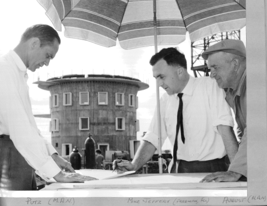 Another of the excellent personal photographic collection taken by Ron Tindall. Looking at plans under a beach umbrella are (left to right) Mr Putz, Mike Jeffery (Project Director) and Mr August. Source: Ron Tindall (photogrpaher)