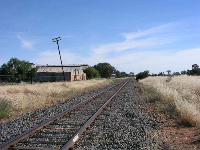 The view looking south from the one-time station location shows what appears to be the old meat freezing works, which were served by several sidings. Source: NSWRail.net website