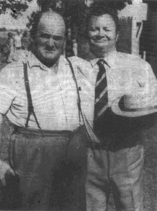 "Photograph in the local newspaper of Harry Secombe and his ""stand-in"", Carl Christopher of Parkes. Carl is a labourer and general ""handy-man"" by occupation and was chosen for Harry's stand-in at Parkes because of his similar height and size. In the report accompanying the photograph, Secombe is described as a ""warm, friendly human being"" loving his time in Australia and Parkes despite the continuous presence of the Australian bush flies! Source: Parkes Champion Post Wednesday January 19, 1972 p.10"