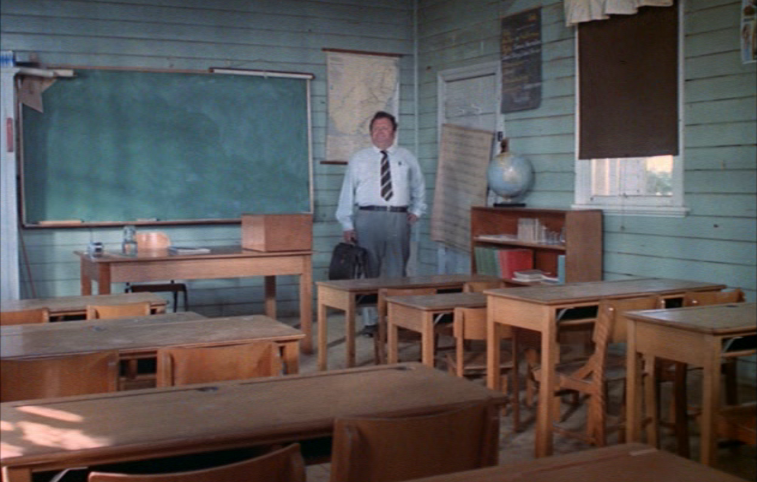 Stanley Evans (Harry Secombe) inside the Kookaburra Springs school building. Wongalea Public School building looks pretty much the same, now at its permanent home at the Henry Parkes Centre. Source: Sunstruck [Motion picture; DVD release] England: Studiocanal, 1972, 0:16:21