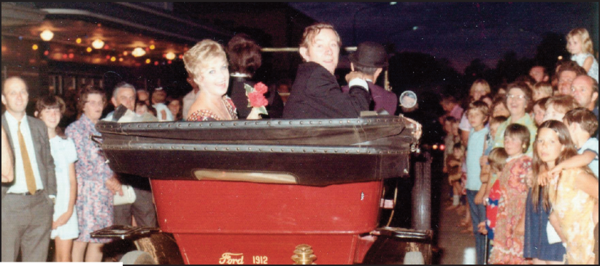 Maggie Fitzgibbon and John Mellion [sic] arrive at the entrance to the theatre in a vintage car. Source: Parkes Champion Post Monday January 6, 2014 p.5